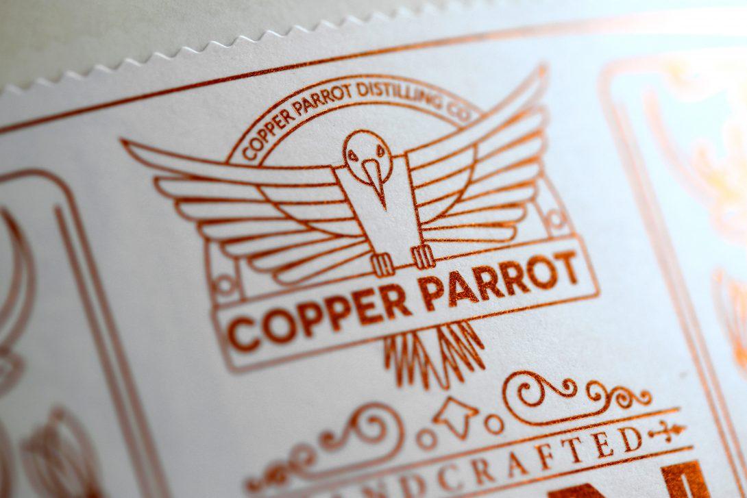 Detail Logo Copper Parrot Kupfer Praegeetikett
